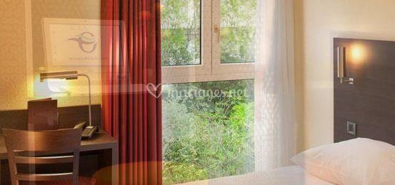 Chambre avec vue sur le jardin