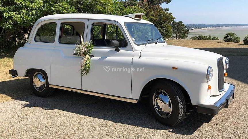 Notre taxi anglais blanc