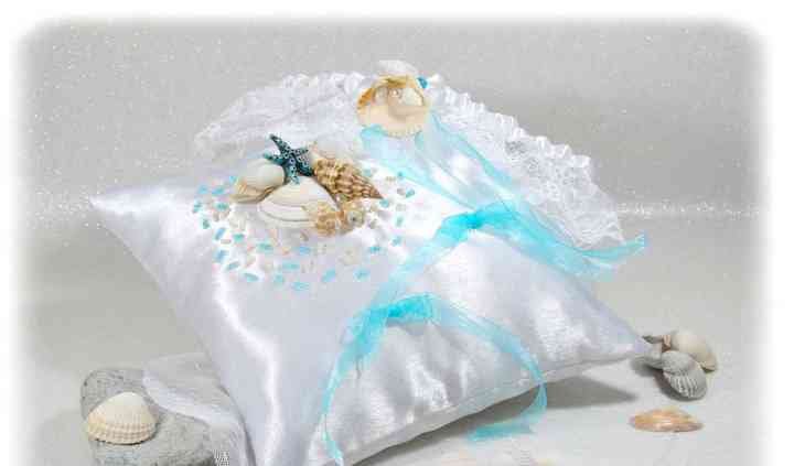 Coussin alliances coquillages