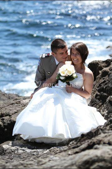 Photo de couple au bord de mer