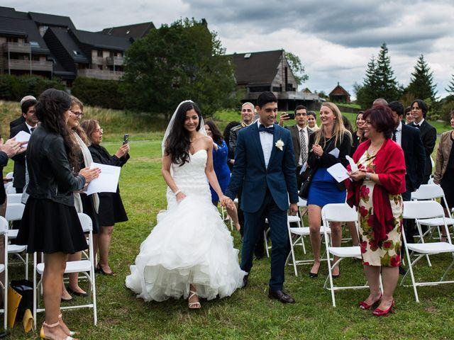 Le mariage de Nima et Mélody à Chambon-sur-Lac, Puy-de-Dôme 22